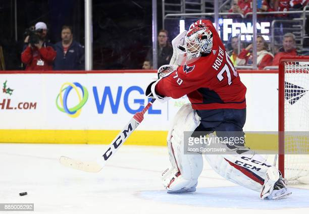 Washington Capitals goalie Braden Holtby clears the puck during a NHL game between the Washington Capitals and the Columbus Blue Jackets on December...