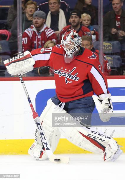 Washington Capitals goalie Braden Holtby comes off his goal line to stop a puck along the boards during a NHL game between the Washington Capitals...