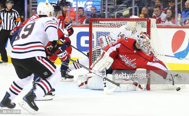Washington Capitals goalie Braden Holtby grabs for the puck at the side of his goal during a NHL game between the Washington Capitals and the Chicago...