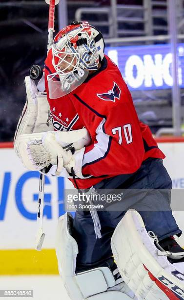 Washington Capitals goalie Braden Holtby leaps up to make a save late in the game during a NHL game between the Washington Capitals and the Columbus...