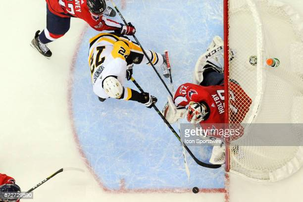 Washington Capitals goalie Braden Holtby makes a first period save on shot by Pittsburgh Penguins right wing Patric Hornqvist on November 10 at the...