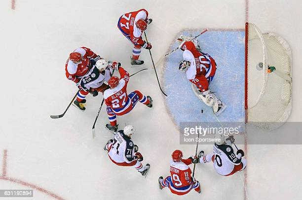 Washington Capitals goalie Braden Holtby makes a save in the first period on a shot by Columbus Blue Jackets center Alexander Wennberg on January 5...