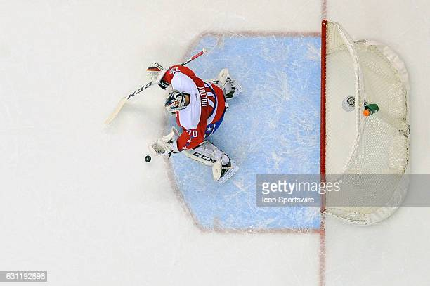 Washington Capitals goalie Braden Holtby makes a save in the first period on a shot by the Columbus Blue Jackets on January 5 at the Verizon Center...