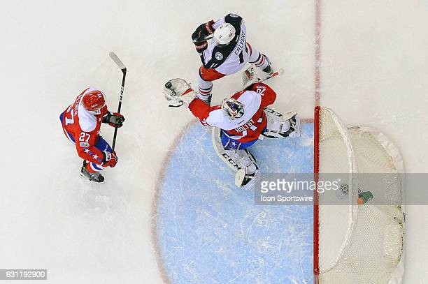 Washington Capitals goalie Braden Holtby makes a save in the first period on a shot by Columbus Blue Jackets left wing Matt Calvert on January 5 at...
