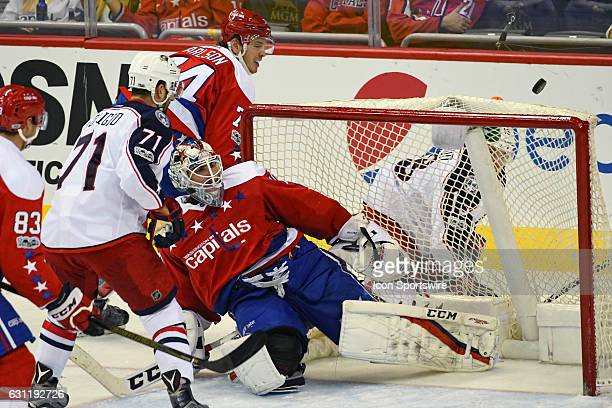Washington Capitals goalie Braden Holtby makes a save in the third period on a shot by Columbus Blue Jackets left wing Nick Foligno on January 5 at...