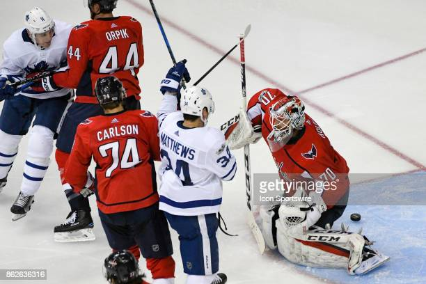 Washington Capitals goalie Braden Holtby makes a save in the third period on a shot by Toronto Maple Leafs center Zach Hyman on October 17 at the...
