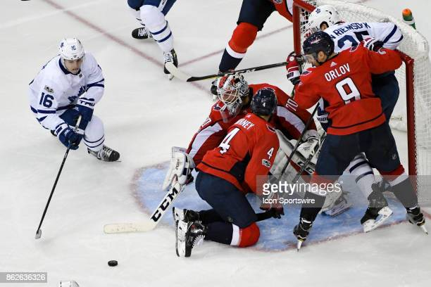 Washington Capitals goalie Braden Holtby makes a save in the third period on a shot by Toronto Maple Leafs center Mitchell Marner on October 17 at...