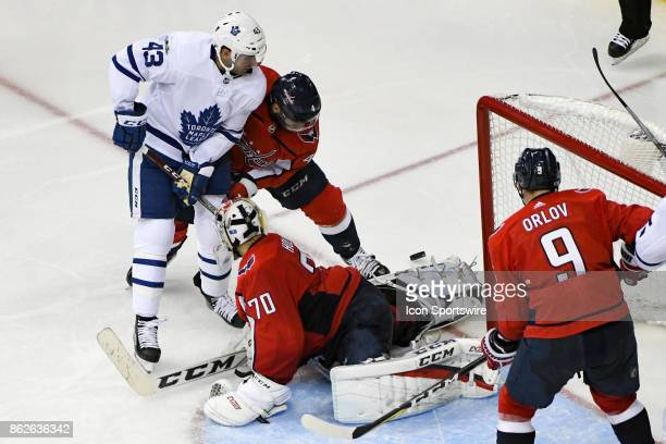 Washington Capitals goalie Braden Holtby makes a save in the third period on a shot by Toronto Maple Leafs center Nazem Kadri on October 17 at the...