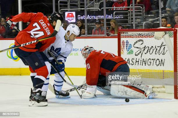 Washington Capitals goalie Braden Holtby makes a save on a first period shot by Toronto Maple Leafs left wing Matt Martin on October 17 at the...