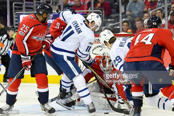 Washington Capitals goalie Braden Holtby makes a save on a first period shot by Toronto Maple Leafs center Zach Hyman on October 17 at the Verizon...