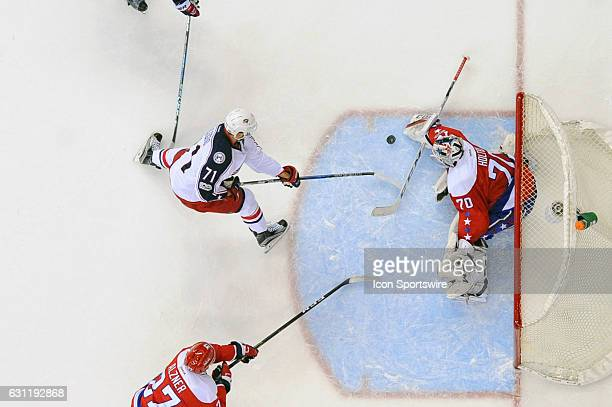 Washington Capitals goalie Braden Holtby makes a save on a shot by Columbus Blue Jackets left wing Nick Foligno in the third period on January 5 at...