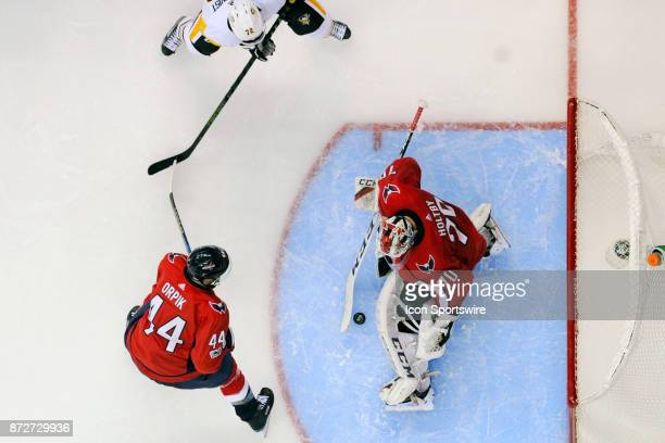 Washington Capitals goalie Braden Holtby makes a third period save on shot by Pittsburgh Penguins right wing Patric Hornqvist on November 10 at the...