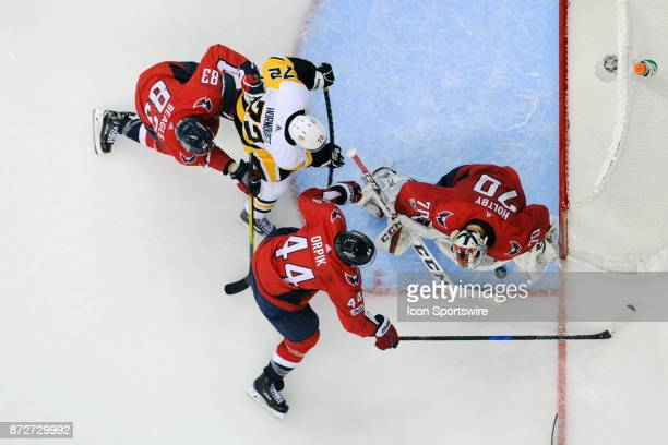 Washington Capitals goalie Braden Holtby makes a third period save on shot by Pittsburgh Penguins right wing Patric Hornqvist who is defended by...
