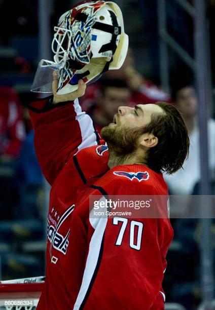 Washington Capitals goalie Braden Holtby puts on his helmet during a NHL game between the Washington Capitals and the Pittsburgh Penguins on October...