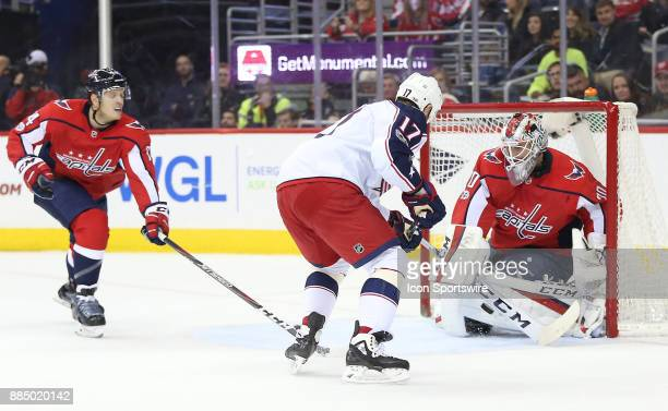 Washington Capitals goalie Braden Holtby saves on a close in shot by Columbus Blue Jackets center Brandon Dubinsky in the first period during a NHL...