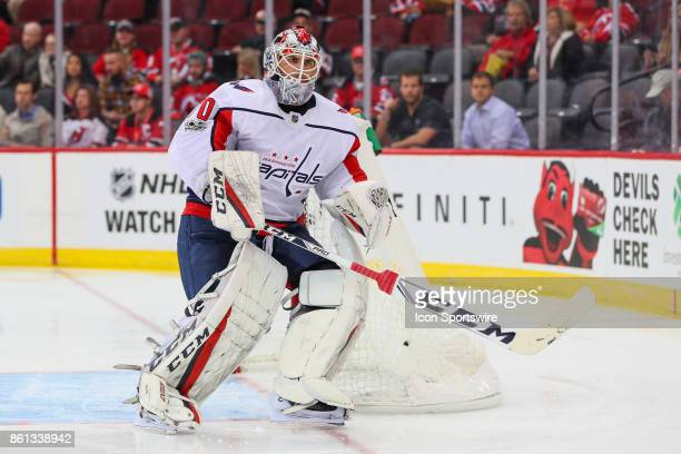 Washington Capitals goalie Braden Holtby skates during the first period of the National Hockey League game between the New Jersey Devils and the...