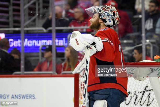 Washington Capitals goalie Braden Holtby spits a stream on water in the first period on October 17 at the Capital One Arena in Washington DC The...