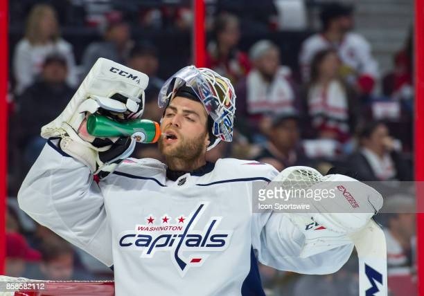 Washington Capitals Goalie Braden Holtby takes a drink during a break in play during the NHL game between the Ottawa Senators and the Washington...