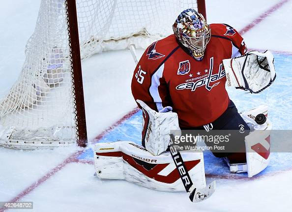 Washington Capitals goalie Justin Peters makes a save during the second period of the game between the Washington Capitals and the St Louis Blues at...