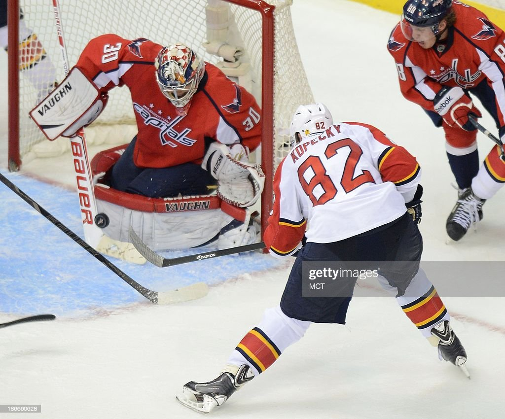 Washington Capitals goalie Michal Neuvirth (30) makes a save against Florida Panthers center Tomas Kopecky (82) late in the third period at the Verizon Center in Washington, D.C., Saturday, November 2, 2013. The Capitals defeated the Panthers in a shootout, 3-2.