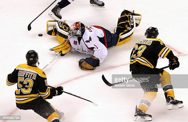 Washington Capitals goalie Pheonix Copley came far out of his crease to play the puck on Boston Bruins left wing Brad Marchand break away attempt...