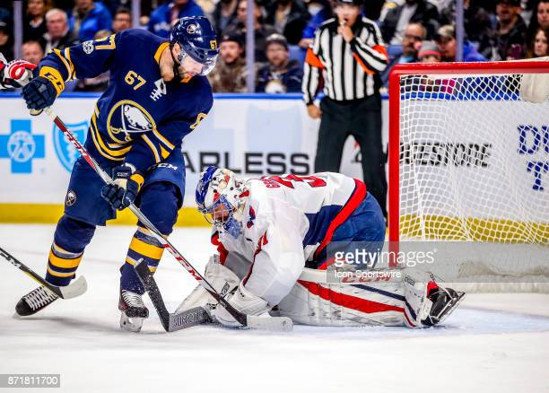 Washington Capitals goalie Philipp Grubauer covers up the puck in front of Buffalo Sabres left wing Benoit Pouliot during an NHL game between the...