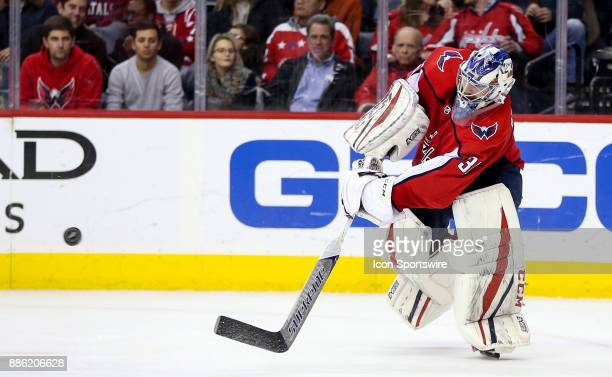 Washington Capitals goalie Philipp Grubauer flicks the puck up ice during a NHL game between the Washington Capitals and the San Jose Sharks on...