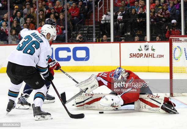 Washington Capitals goalie Philipp Grubauer grabs the puck in front of San Jose Sharks right wing Jannik Hansen during a NHL game between the...