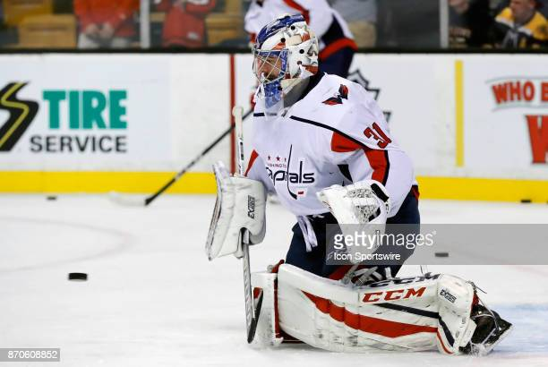 Washington Capitals goalie Philipp Grubauer makes a stop in warm up before a game between the Boston Bruins and the Washington Capitals on November 4...