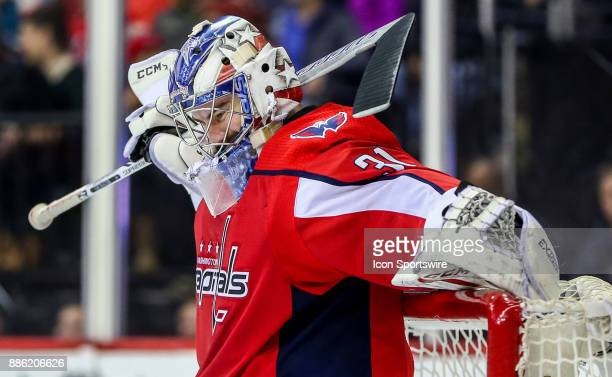 Washington Capitals goalie Philipp Grubauer scratches his back during a NHL game between the Washington Capitals and the San Jose Sharks on December...