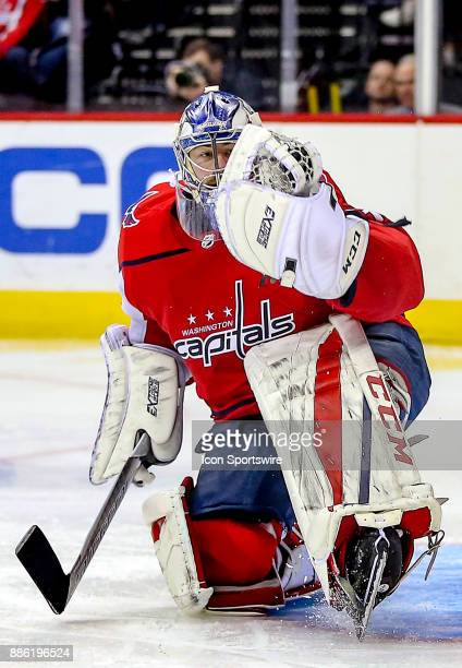 Washington Capitals goalie Philipp Grubauer snaps up a shot in his mitt during a NHL game between the Washington Capitals and the San Jose Sharks on...