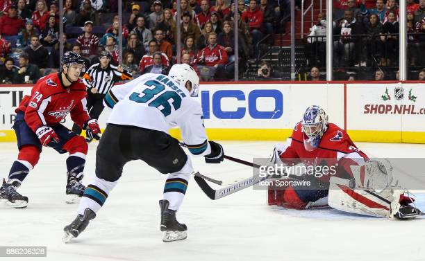 Washington Capitals goalie Philipp Grubauer stops a point blank shot from San Jose Sharks right wing Jannik Hansen during a NHL game between the...