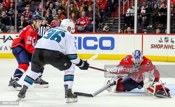 Washington Capitals goalie Philipp Grubauer stops a shot from San Jose Sharks right wing Jannik Hansen during a NHL game between the Washington...
