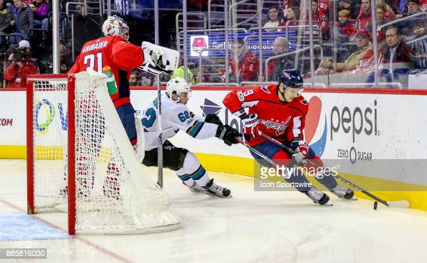 Washington Capitals goalie Philipp Grubauer watches as defenseman Dmitry Orlov skates away with the puck with San Jose Sharks right wing Kevin Labanc...