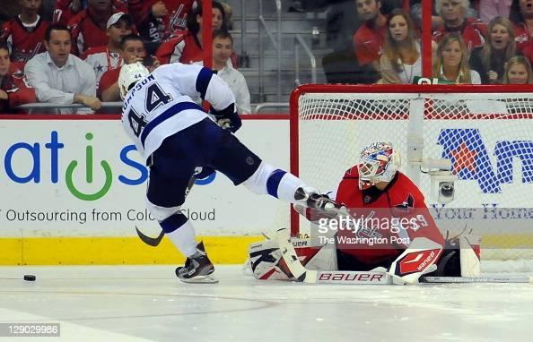 Washington Capitals goalie Tomas Vokoun denies Tampa Bay Lightning center Nate Thompson a shootout goal at the Verizon Center on October 10 2011 in...
