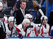 Washington Capitals head coach Adam Oates follows the action against the New York Rangers in Game Three of the Eastern Conference Quarterfinals...