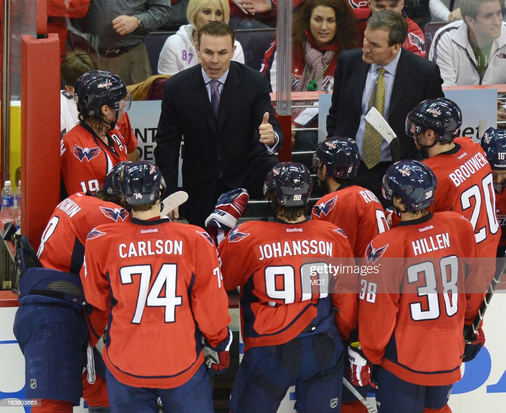 Washington Capitals head coach Adam Oates huddles with his players during a timeout in the third period against the Buffalo Sabres at the Verizon Center in Washington, D.C., Sunday, March 17, 2013. The Capitals beat the Sabres, 5-3.