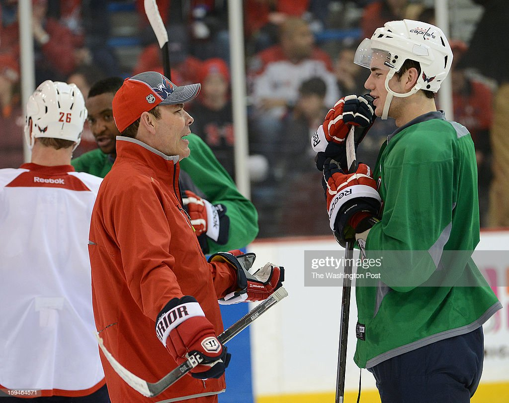Washington Capitals head coach Adam Oates, left, talks with Washington Capitals forward Tom Wilson, the team's 2012 first round draft pick, after the Washington Capitals' first official practice of the season on Sunday, January 13, 2013.