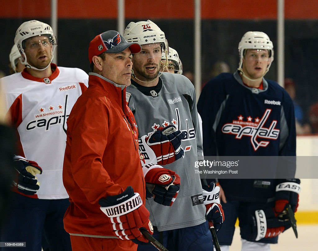 Washington Capitals head coach Adam Oates, left, talks with Washington Capitals right wing Troy Brouwer (20) during the Washington Capitals' first official practice of the season on Sunday, January 13, 2013.