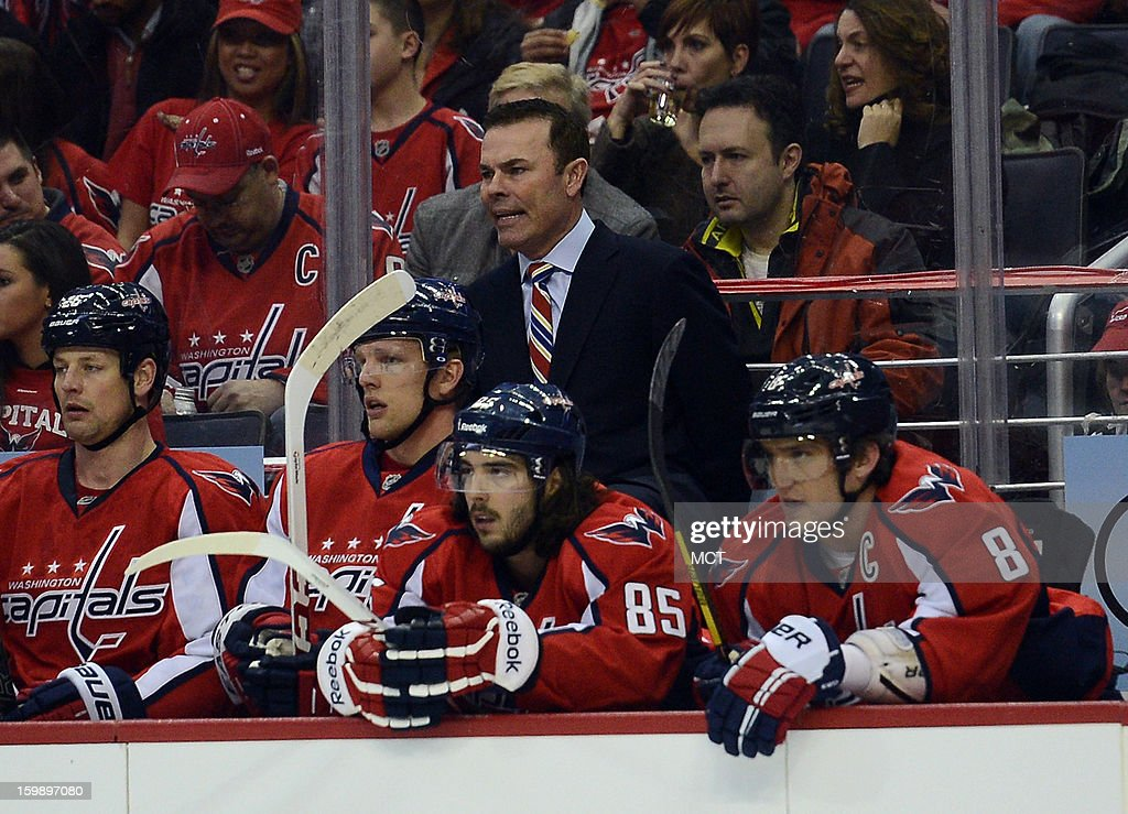 Washington Capitals head coach Adam Oates speaks to his players on the bench in the first period against the Winnipeg Jets at the Verizon Center in Washington, D.C., Tuesday, January 22, 2013.