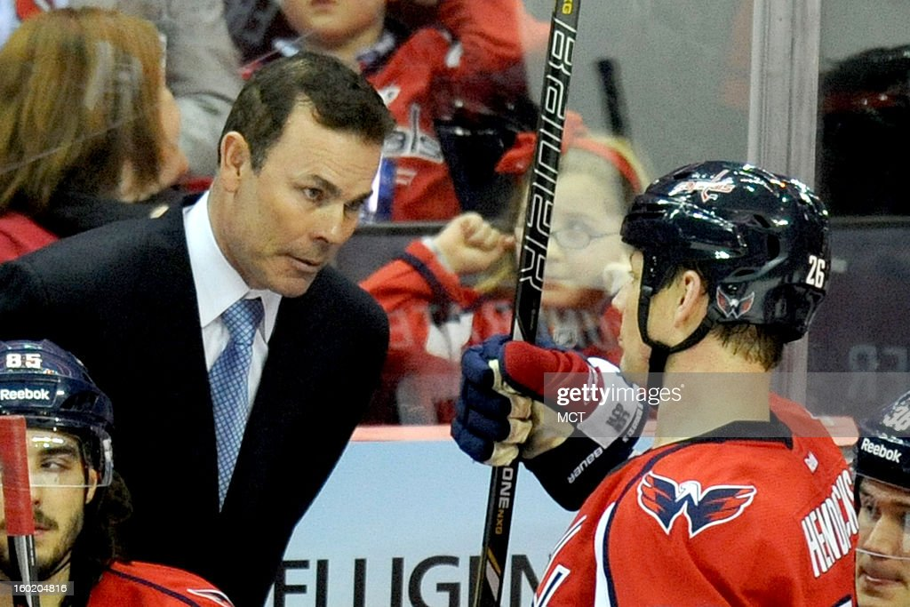 Washington Capitals head coach Adam Oates talks with Washington Capitals center Matt Hendricks (26) during a time out in third-period action against the Buffalo Sabres at the Verizon Center in Washington, D.C., Sunday, January 27, 2013. The Washington Capitals defeated the Buffalo Sabres, 3-2.