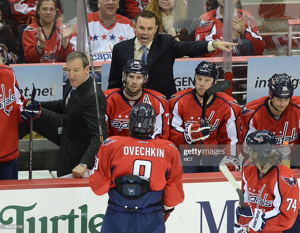 Washington Capitals head coach Adam Oates, top center, gives directions to Washington Capitals left wing Alex Ovechkin (8) in the third period at the Verizon Center in Washington, D.C., Thursday, February 21, 2013. The Devils defeated the Capitals, 3-2.