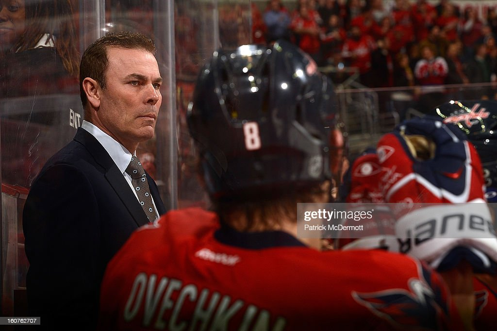 Washington Capitals head coach Adam Oates watches play from the bench during an NHL hockey game betweeen the Philadelphia Flyers and Washington Capitals at Verizon Center on February 1, 2013 in Washington, DC.