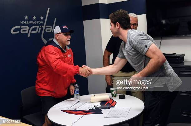 ARLINGTON VA JUNE Washington Capitals head coach Barry Trotz shakes hands with with defensive prospect Connor Hobbs after a meeting at the end of the...