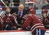Washington Capitals head coach Barry Trotz talks with Alex Ovechkin during a timeout during third period action against the New York Rangers on April...