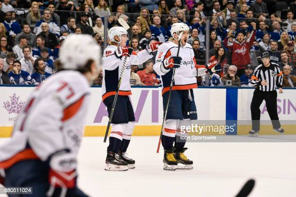 Washington Capitals Left Wing Alex Ovechkin celebrates one of his 3 goals as teammate Left Wing Brett Connolly and Right Wing TJ Oshie join in during...