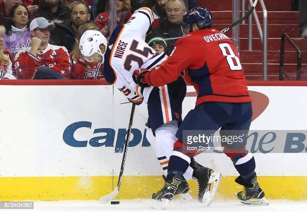 Washington Capitals left wing Alex Ovechkin checks Edmonton Oilers defenseman Darnell Nurse during a NHL game between the Washington Capitals and the...