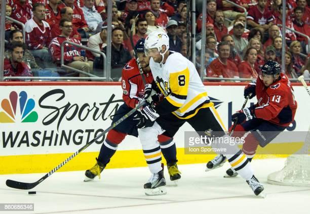 Washington Capitals left wing Alex Ovechkin checks Pittsburgh Penguins defenseman Brian Dumoulin during a NHL game between the Washington Capitals...