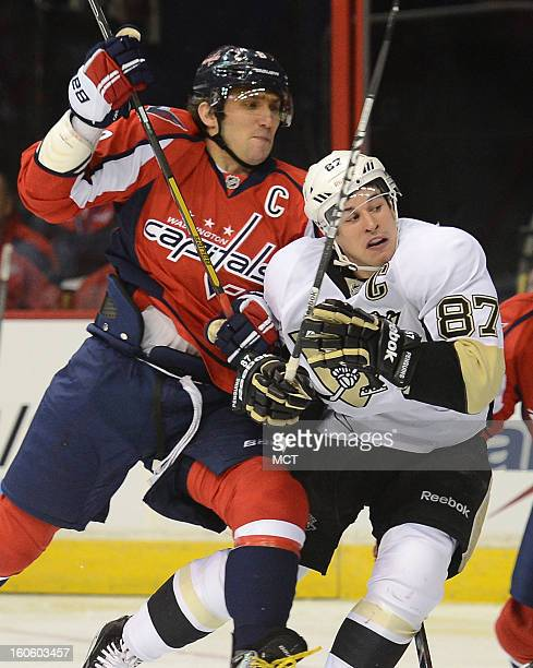 Washington Capitals left wing Alex Ovechkin hits Pittsburgh Penguins center Sidney Crosby after Crosby took a shot at the Capitals goal in the first...