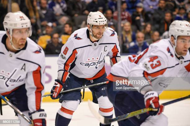 Washington Capitals Left Wing Alex Ovechkin is sandwiched by teammates Defenceman Brooks Orpik and Right Wing Tom Wilson during the NHL regular...